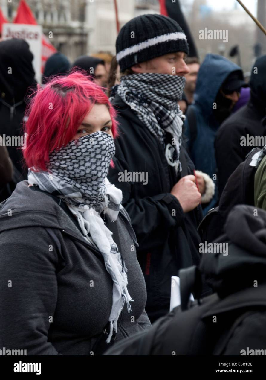 Female anarchist with red hair and bandana covering her face at ...