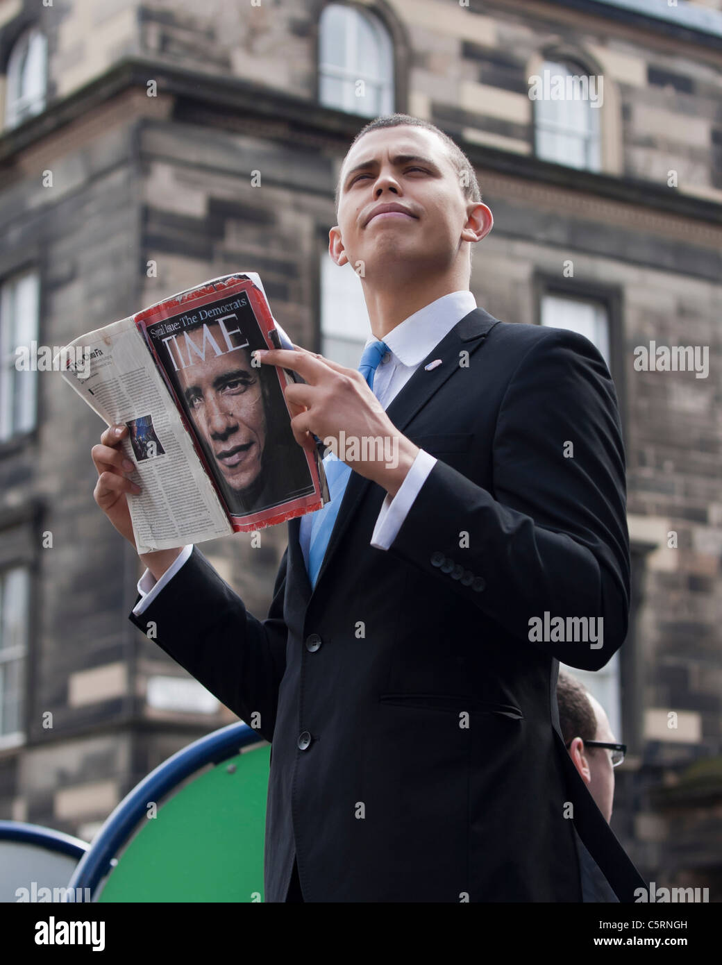 A Barack Obama Look A Like Poses Reading A Copy Of Time Magazine On Stock Photo