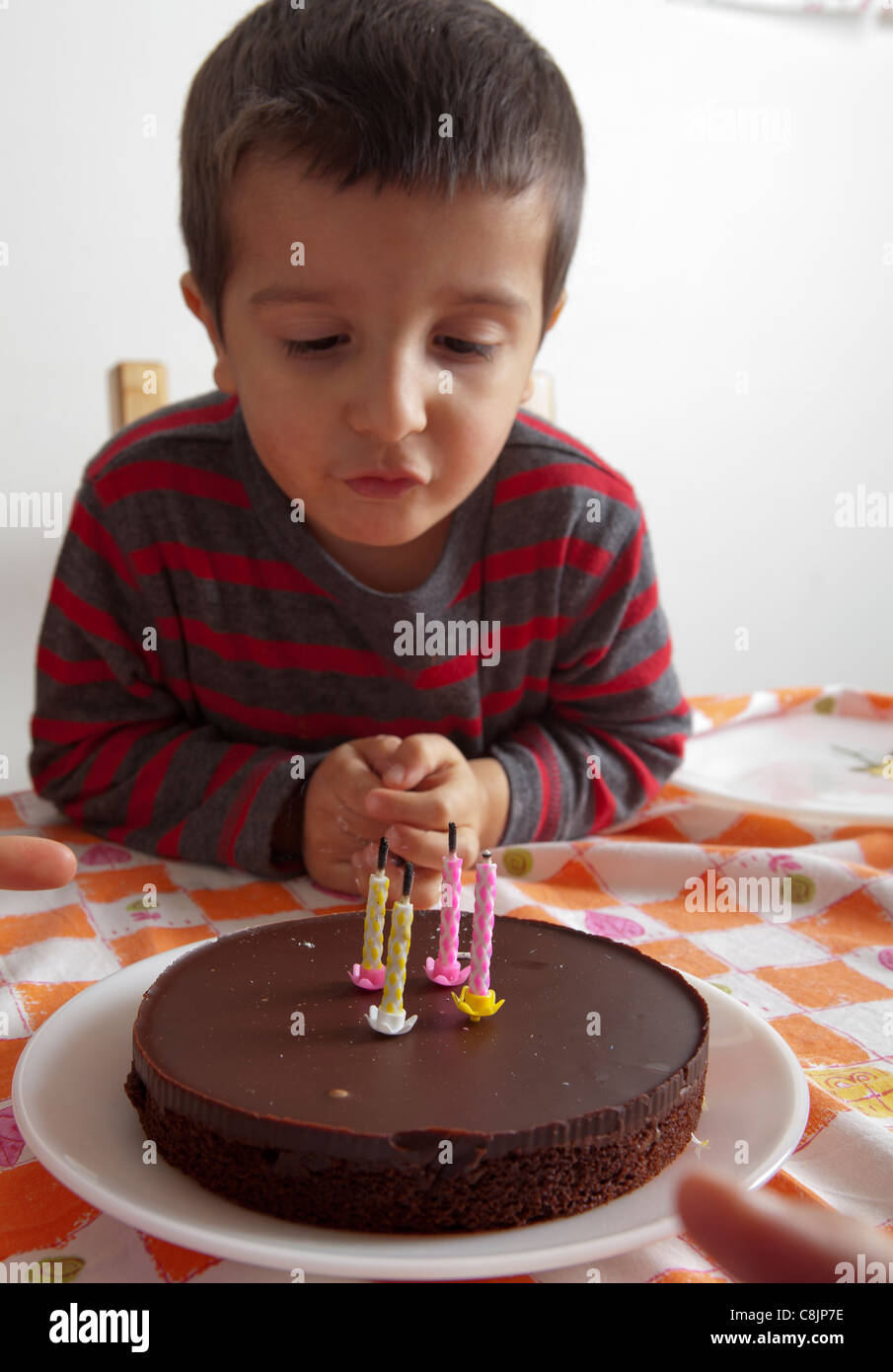 3 Years Old Boy Looking At His Birthday Cake Stock Photo Alamy