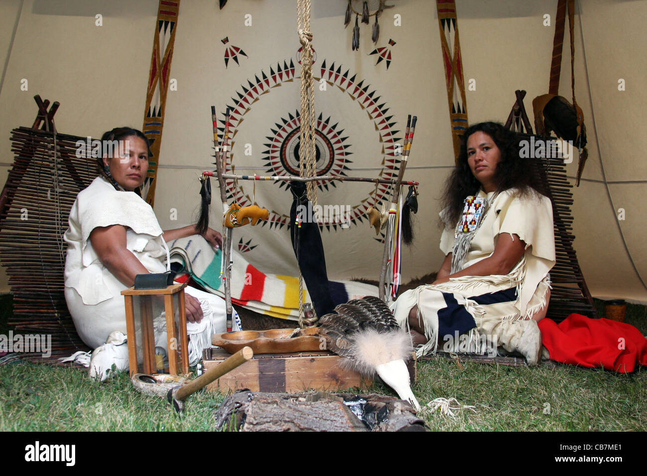 Two Native American Indian Women Sitting Inside A Tipi