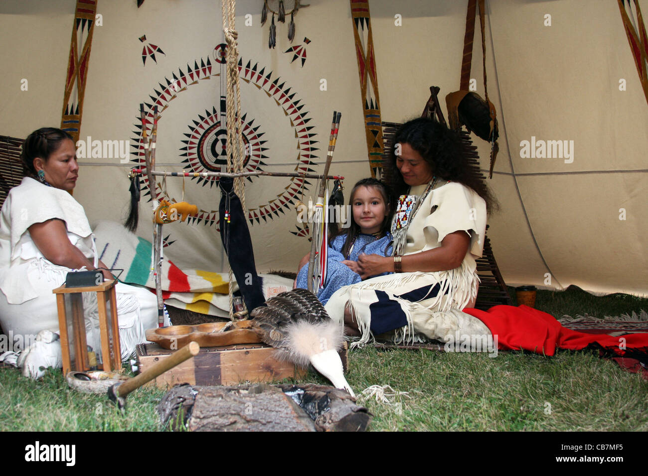 Two Native American Indian Women And A Child Inside A Tipi