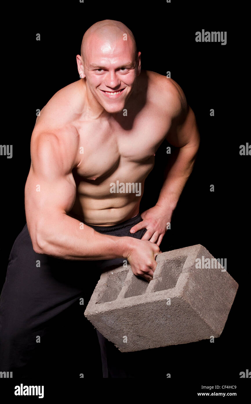 Pumped White Guy Training With Huge Brick