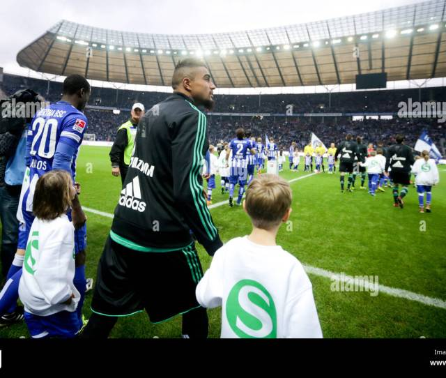 Berlin Germany Nd Nov  Schalkes Kevin Prince Boateng Front R And An Escort Kid Enter The Pitch During The German Bundesliga Match Between