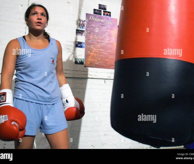 Amateur Boxing Champion Nicole Silveira Rests After Working Out On The Heavy Bag At A Gym