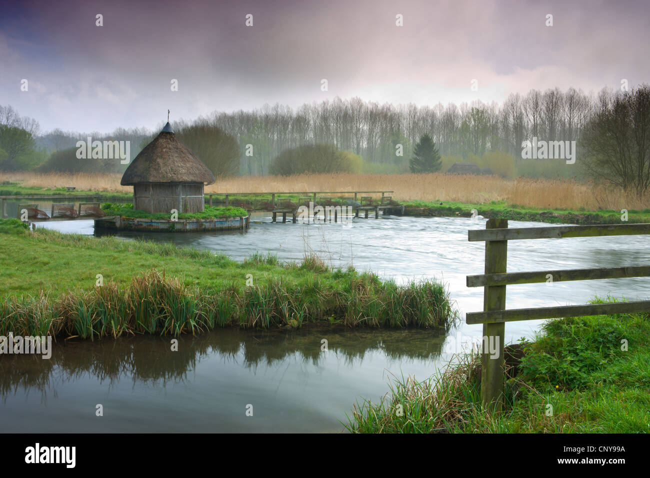 Thatched Fisherman S Hut And Eel Traps Spanning The River Test Near Stock Photo Royalty Free
