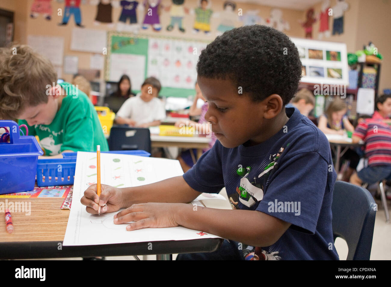 African American Male Kindergarten Student Works At His