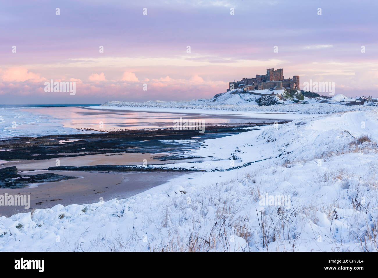 A Snow Covered Winter Scene At Sunset Bamburgh Castle