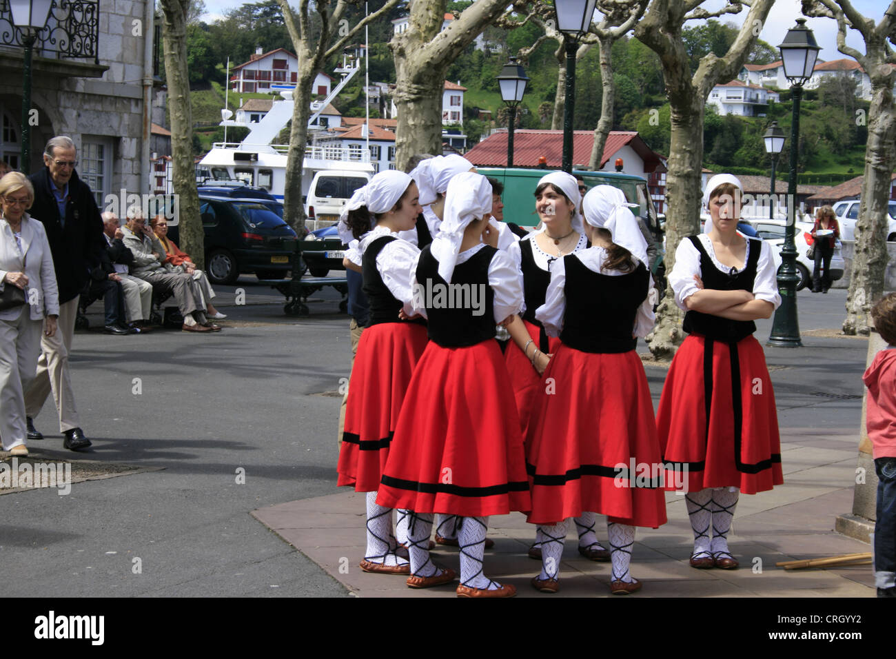 Young Girls Wearing Traditional Basque Costume In Saint