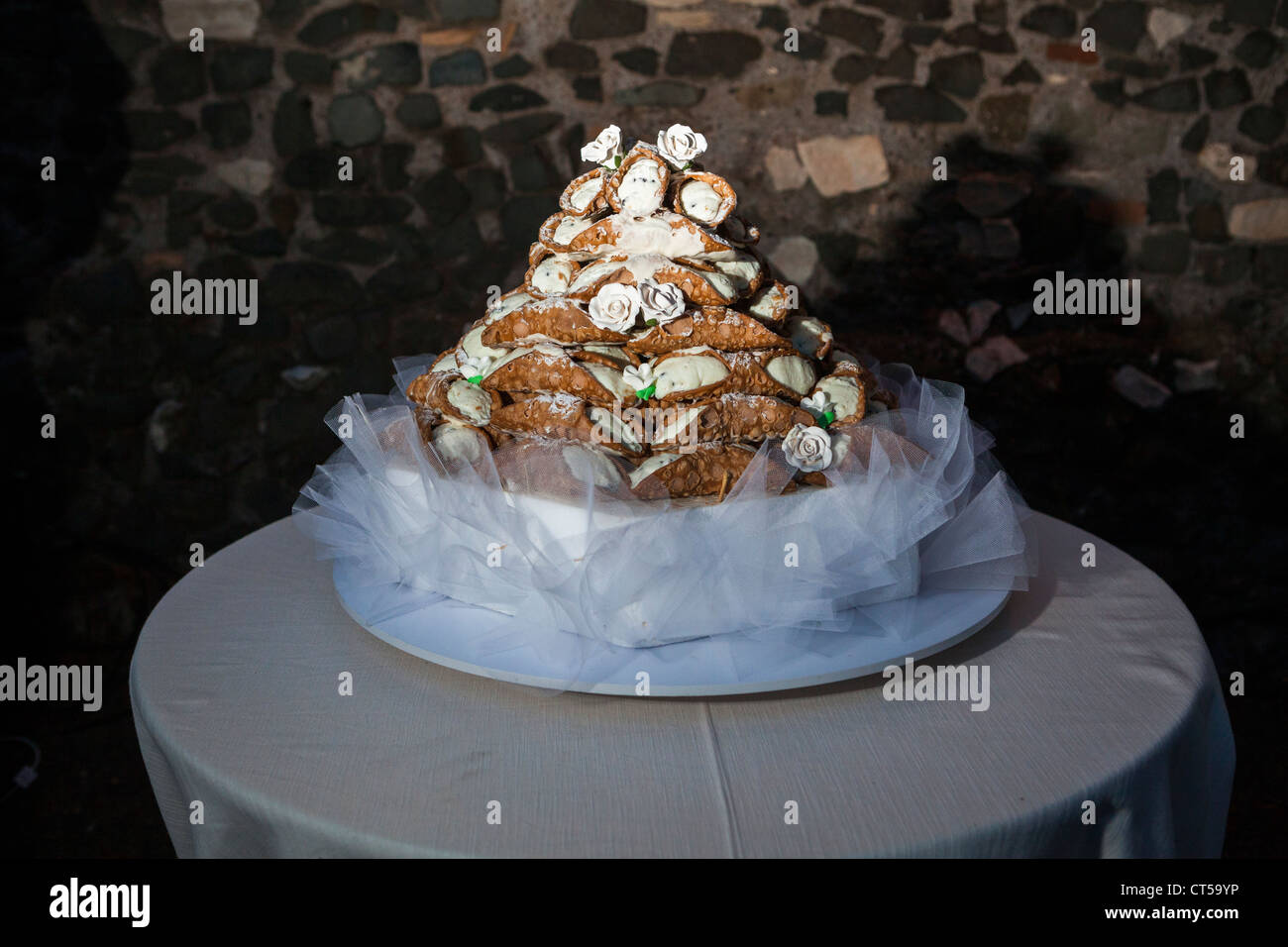 Traditional Cannoli Cake on table at wedding reception Stock Photo     Traditional Cannoli Cake on table at wedding reception