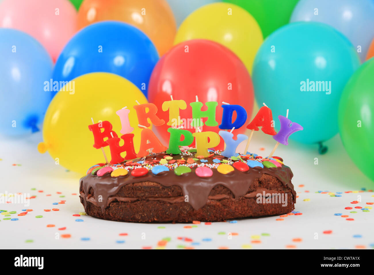Happy Birthday Chocolate Cake With Candles And Balloons Stock Photo Alamy