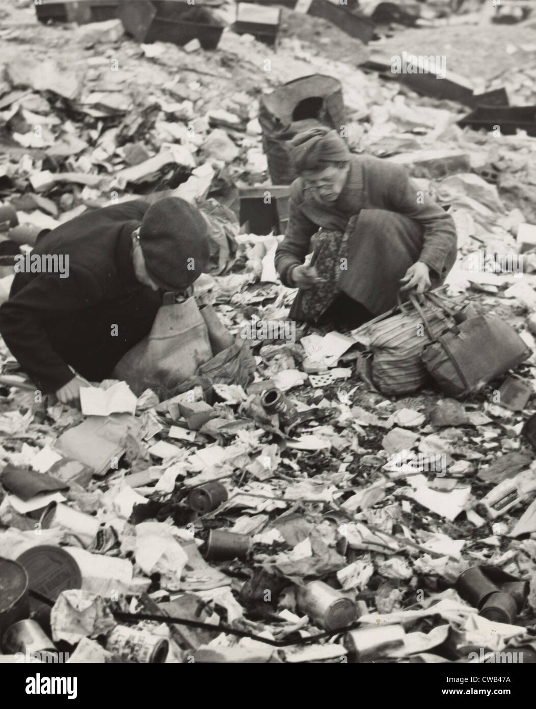 World War Ii Two Germans Searching For Food In A Garbage