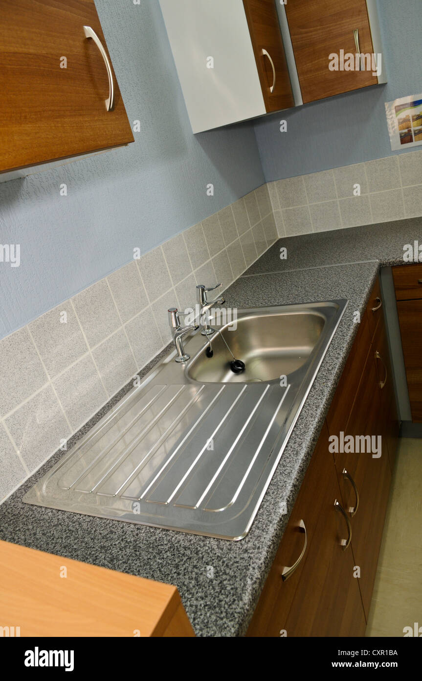 https www alamy com stock photo boring stainless steel kitchen sink and dull wooden kitchen cupboards 50907790 html