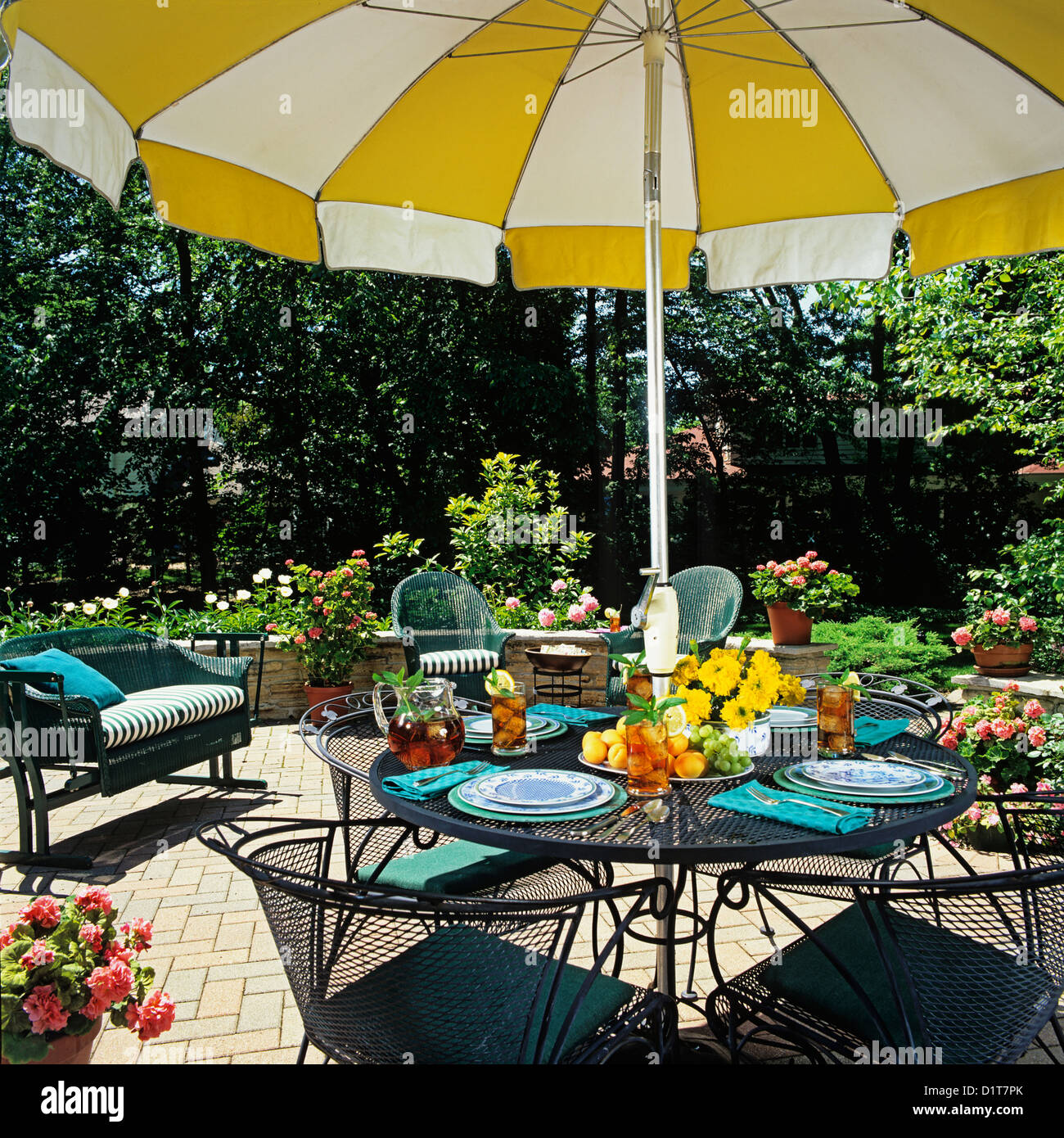 https www alamy com stock photo patios close up umbrella table and surrounding wicker furniture small 52778731 html