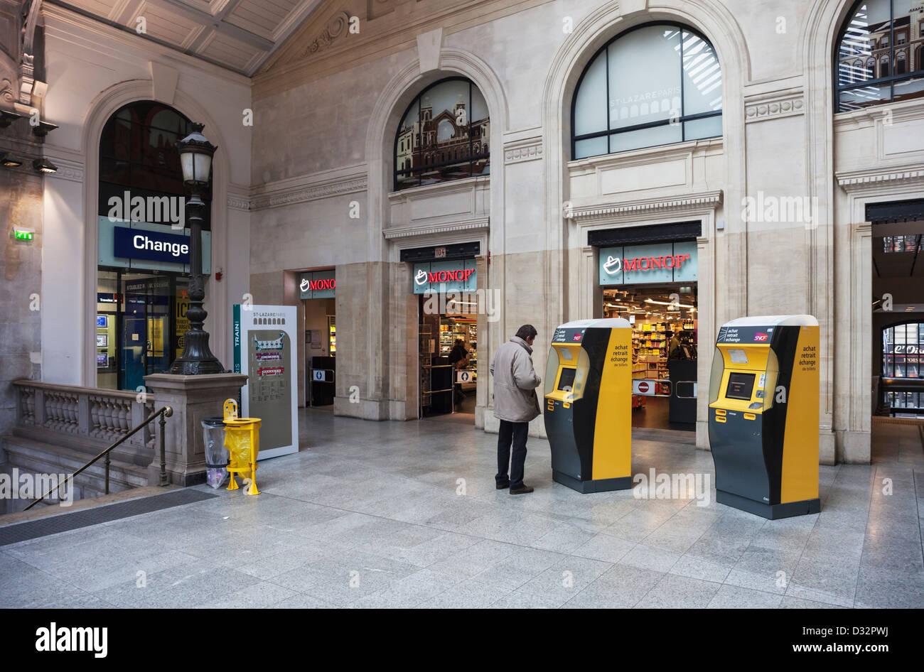 gare st lazare railway station in paris with ticket machines monop convenience store and bureau de change paris france