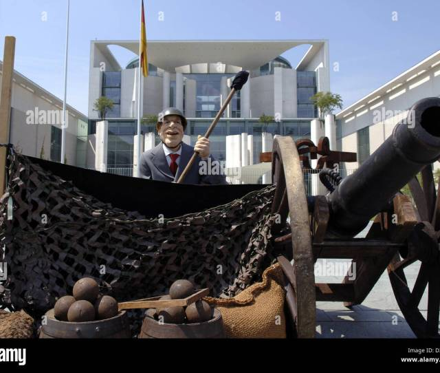 Dpa A Latex Doll Depicting German Chancellor Gerhardt Schroeder Sits On A Canon In Front Of The Chancellery In Berlin Germany Thursday