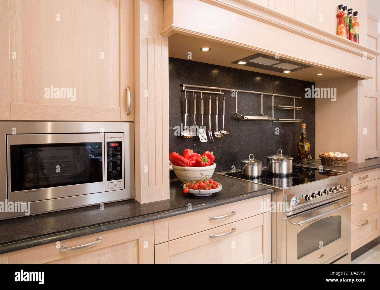 https www alamy com stock photo built in microwave in modern spanish kitchen with chrome utensils 54141446 html