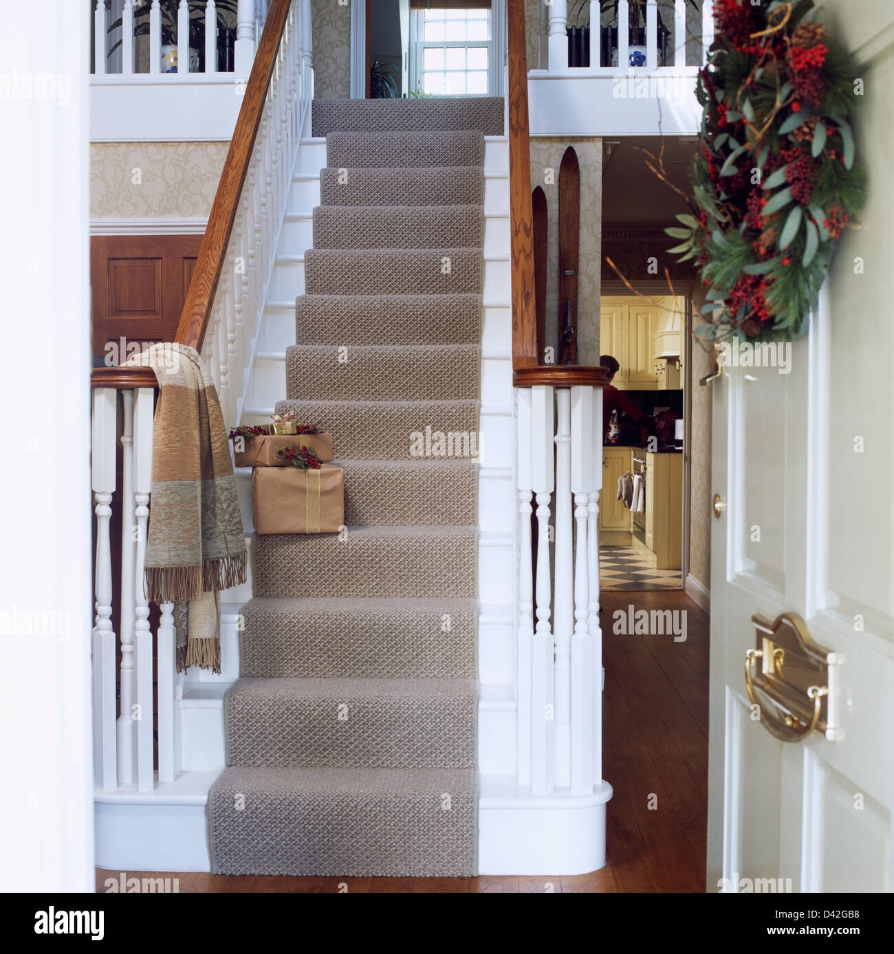 Grey Carpet On White Staircase With Wrapped Christmas Presents In | White Stairs With Carpet | Black | Chic | Victorian Staircase Carpet | Hardwood | Pinstripe Grey