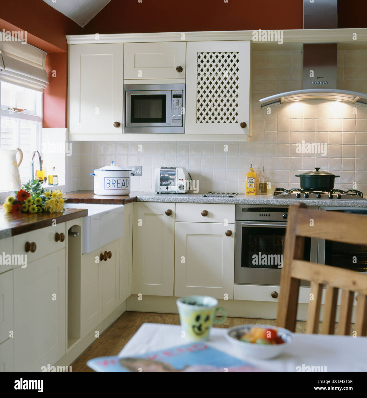 https www alamy com stock photo microwave oven fitted in wall cupboard in white cottage kitchen dining 54152611 html