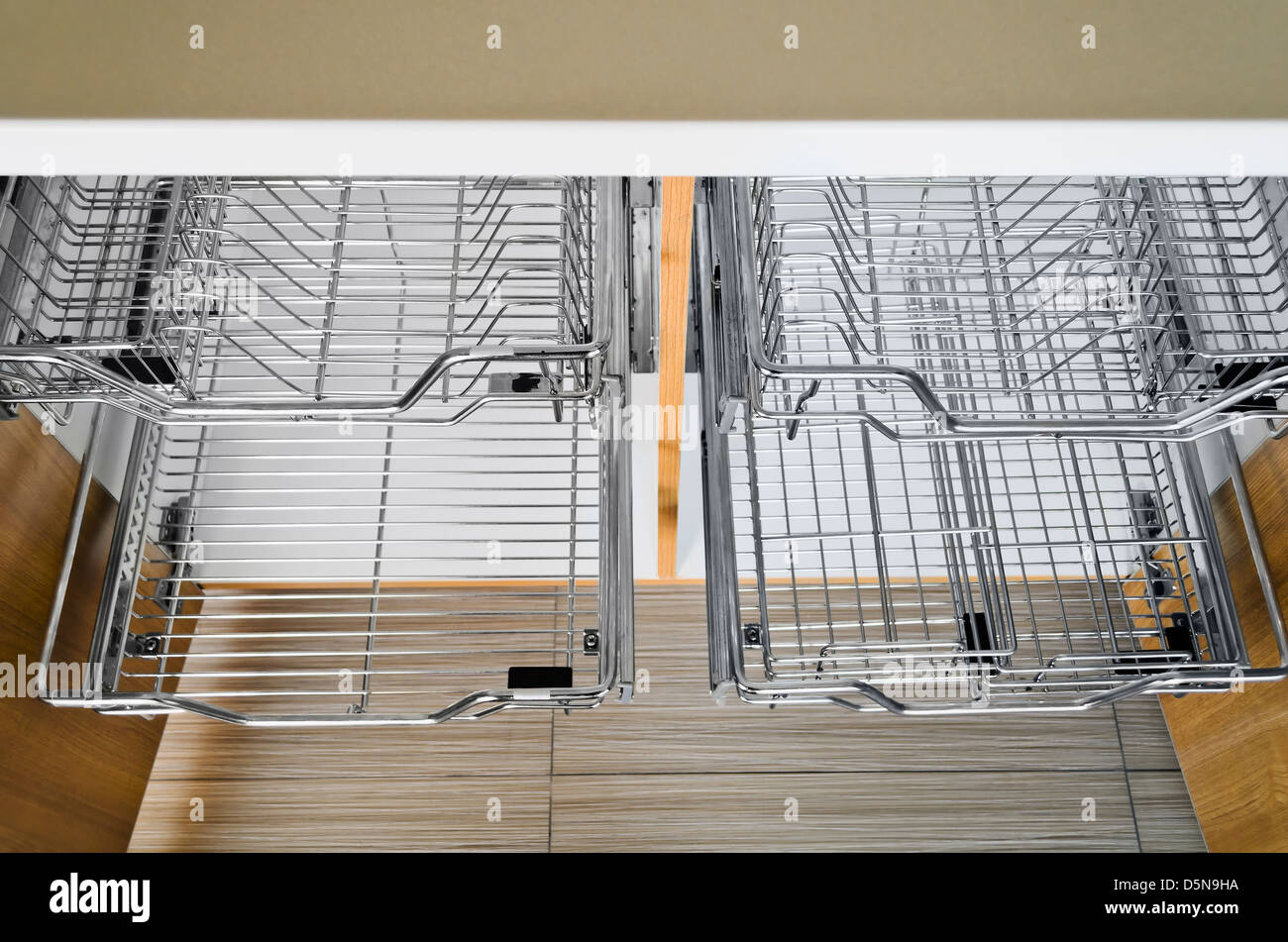 https www alamy com stock photo open kitchen cabinet with two layers of stainless dish rack 55172918 html