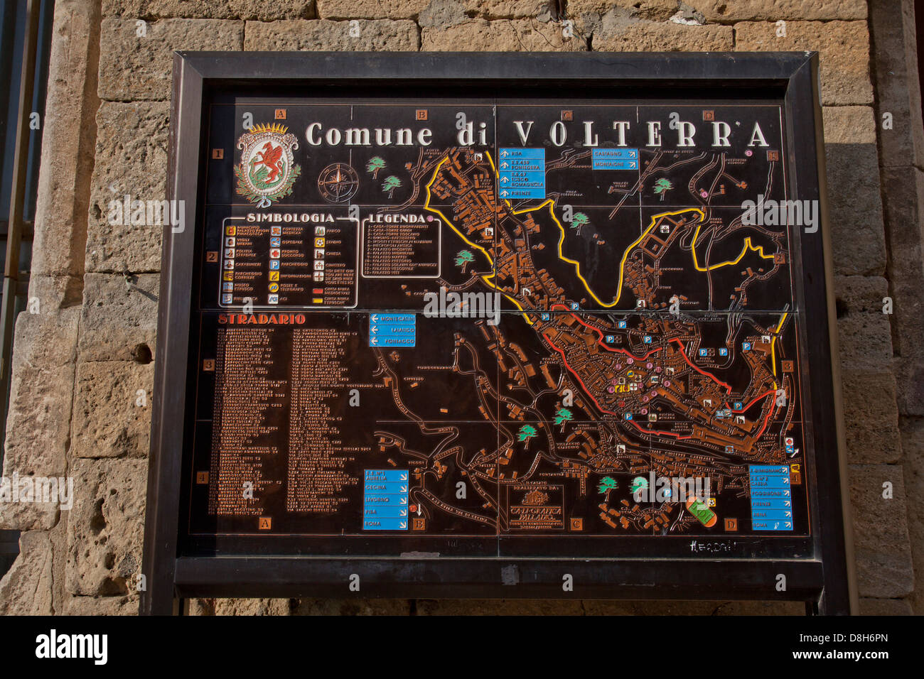 Historical buildings and local map in the old medieval town of Stock     Historical buildings and local map in the old medieval town of  Volterra Tuscany Italy