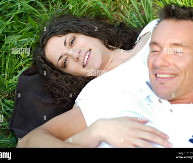 Model Release Young Couple Lying In The Grass Stock Image