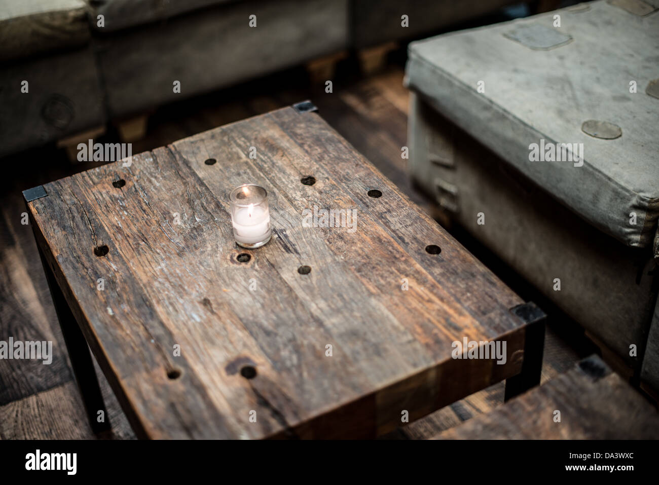 https www alamy com stock photo a small votive candle ssits on a rustic wooden table in a restaurant 57863860 html