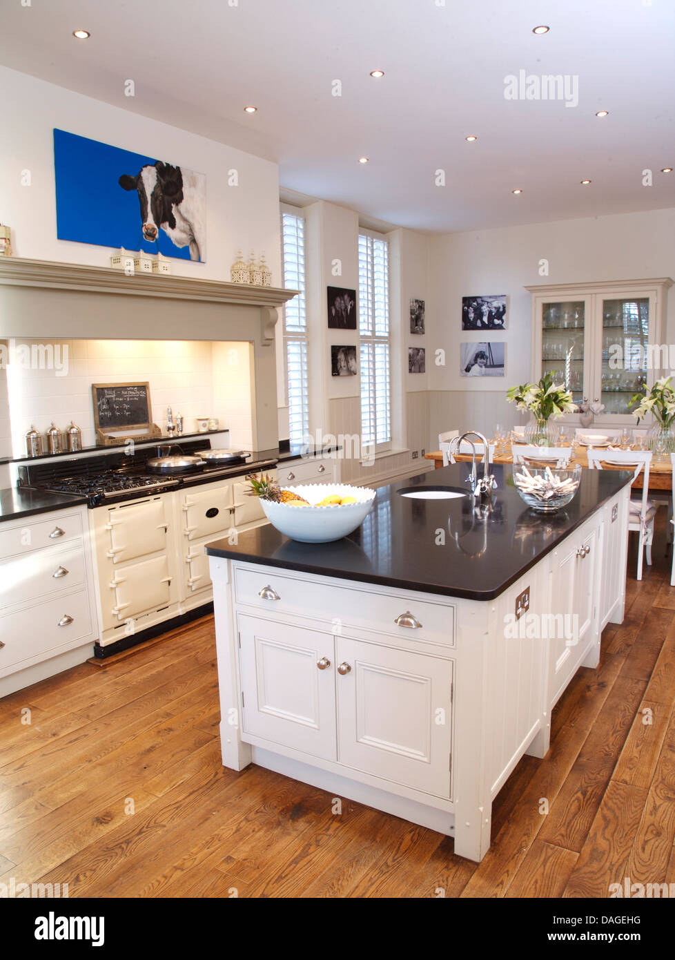 island unit in modern white country kitchen with white aga oven and