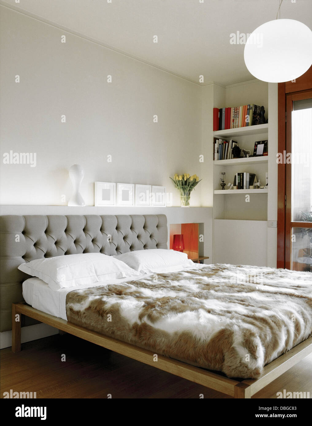 Modern Bed For A Bedroom With Bookcase And Wood Floor Stock