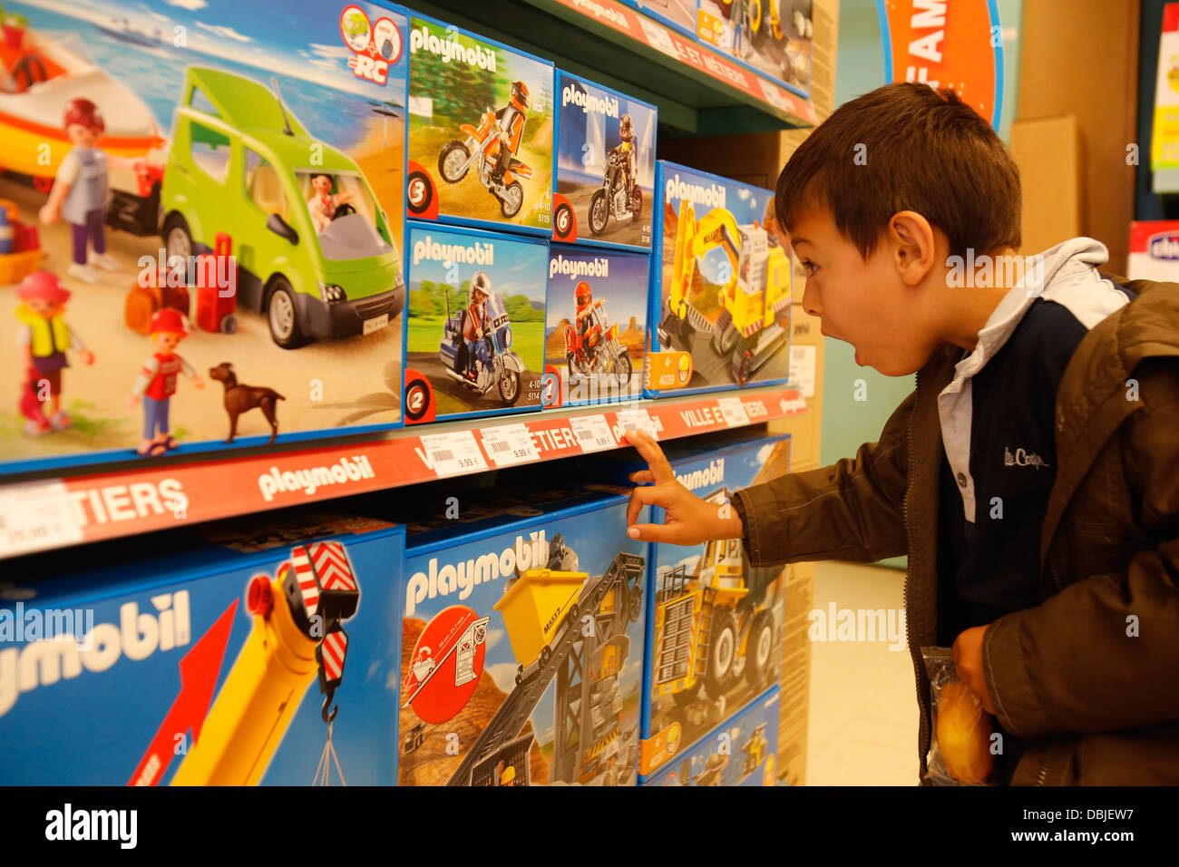 Boy In A Toy Store Stock Photo