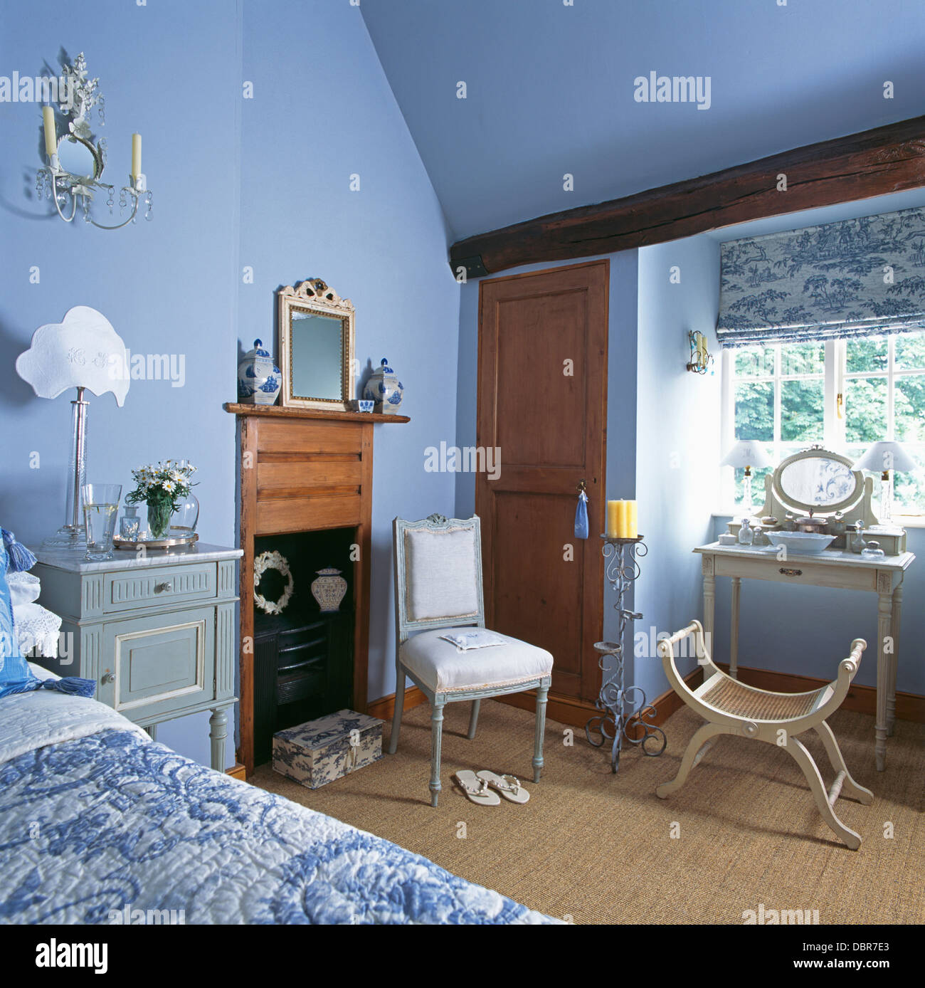 Blue White Toile De Jouy Blind On Window Above Small Dressing Table In Pale Blue Country Bedroom With Fireplace Stock Photo Alamy