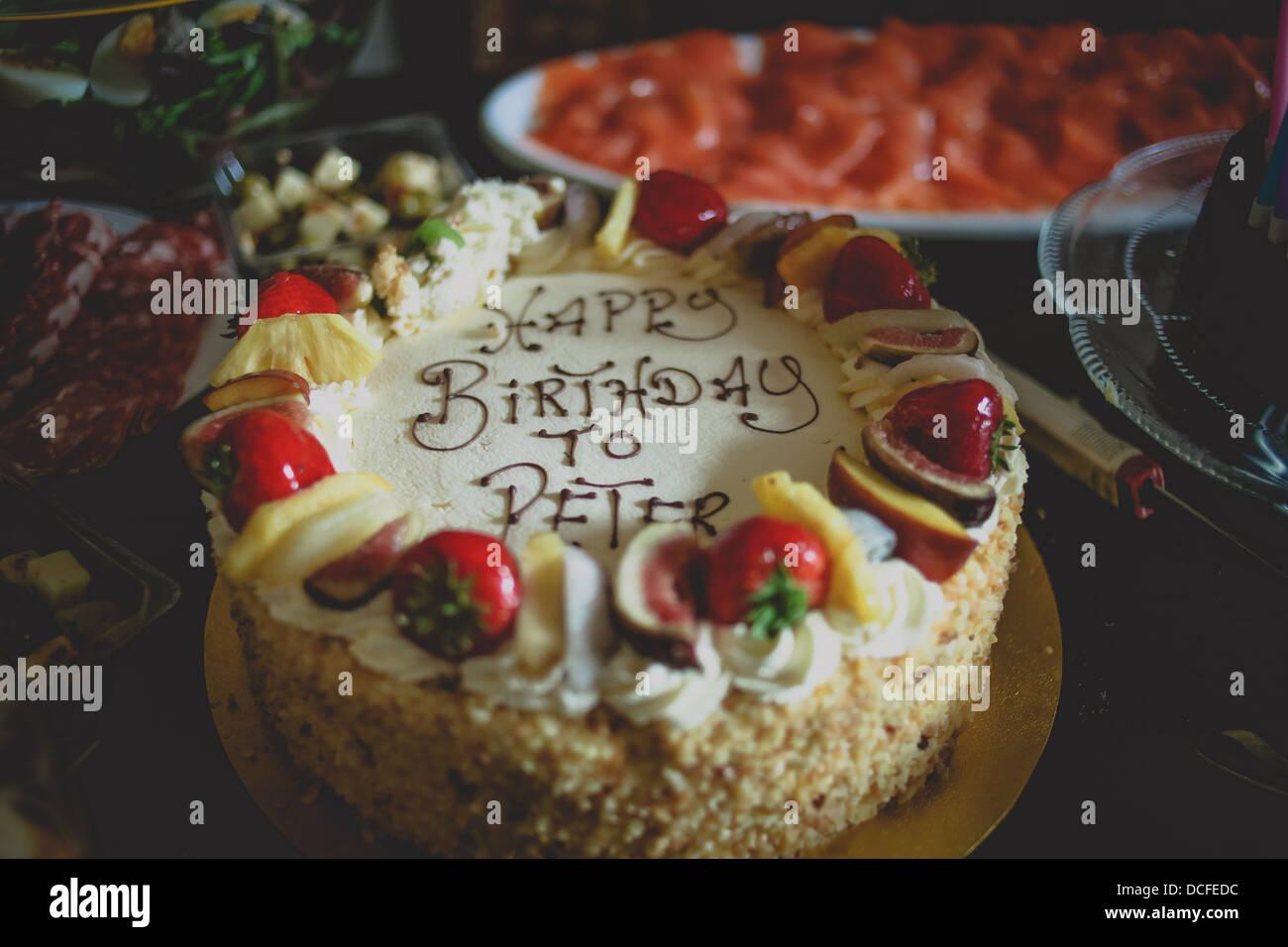 White Chocolate Birthday Cake To Peter Stock Photo Alamy