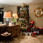 Christmas Tree In Living Room With Antler Decorated Mirror