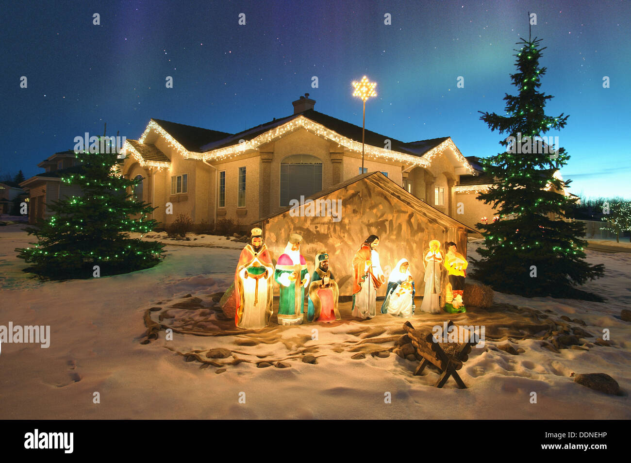 Outdoor Christmas Nativity Scene With Northern Lights