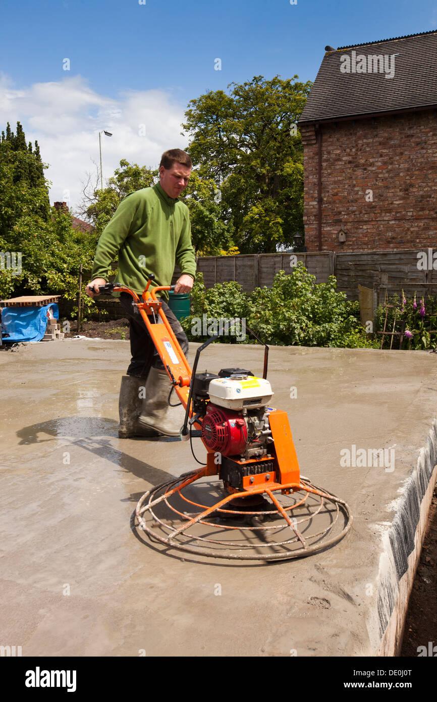 Self Building House Man Using Power Float Mechanical