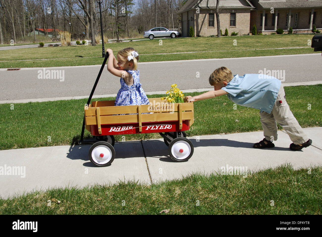 Children In A Wagon Showing The Concept Of Pulling And