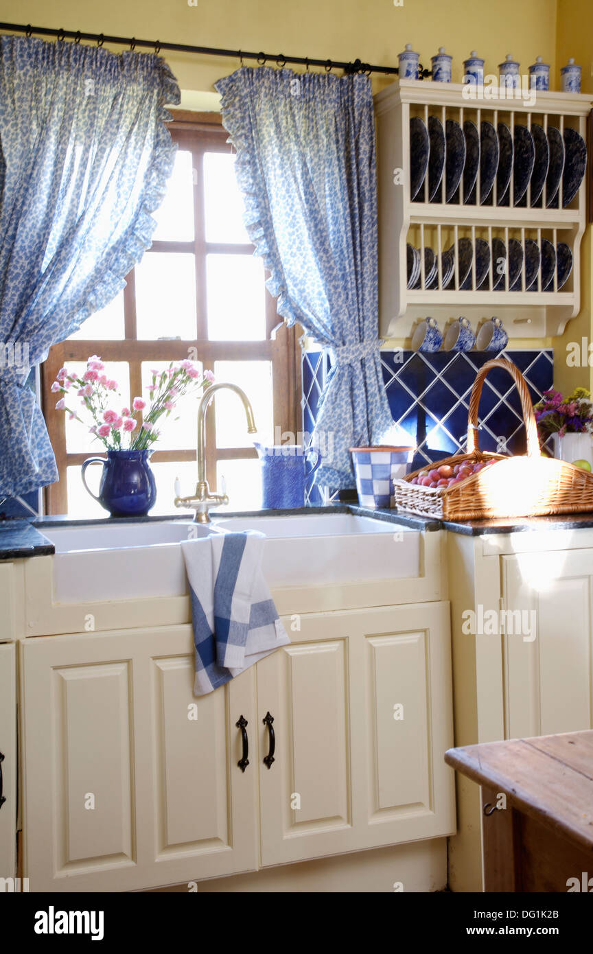 Blue Curtains On Window Above Double Belfast Sinks In