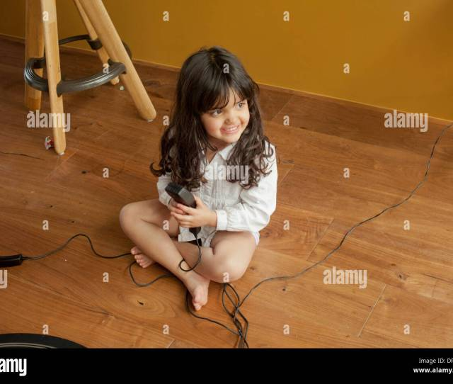 A Little Girl Playing By Herself