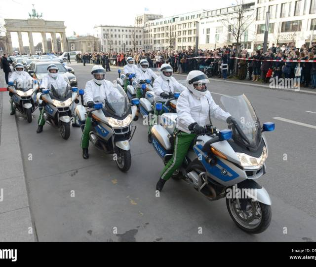 Berlin Germany Th Feb  The Motorcycle Escort Fot He Belgian Royal Couple Leads The Motorcade In Front Of Brandenburg Gate In Berlin Germany