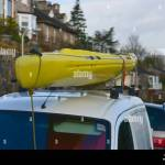 Yellow Kayak On Roofrack Of Van Serpentine Road Kendal Cumbria Stock Photo Alamy