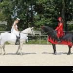 Riding Pas De Deux Angel And Devil Connemara Pony Mare And Stock Photo Alamy