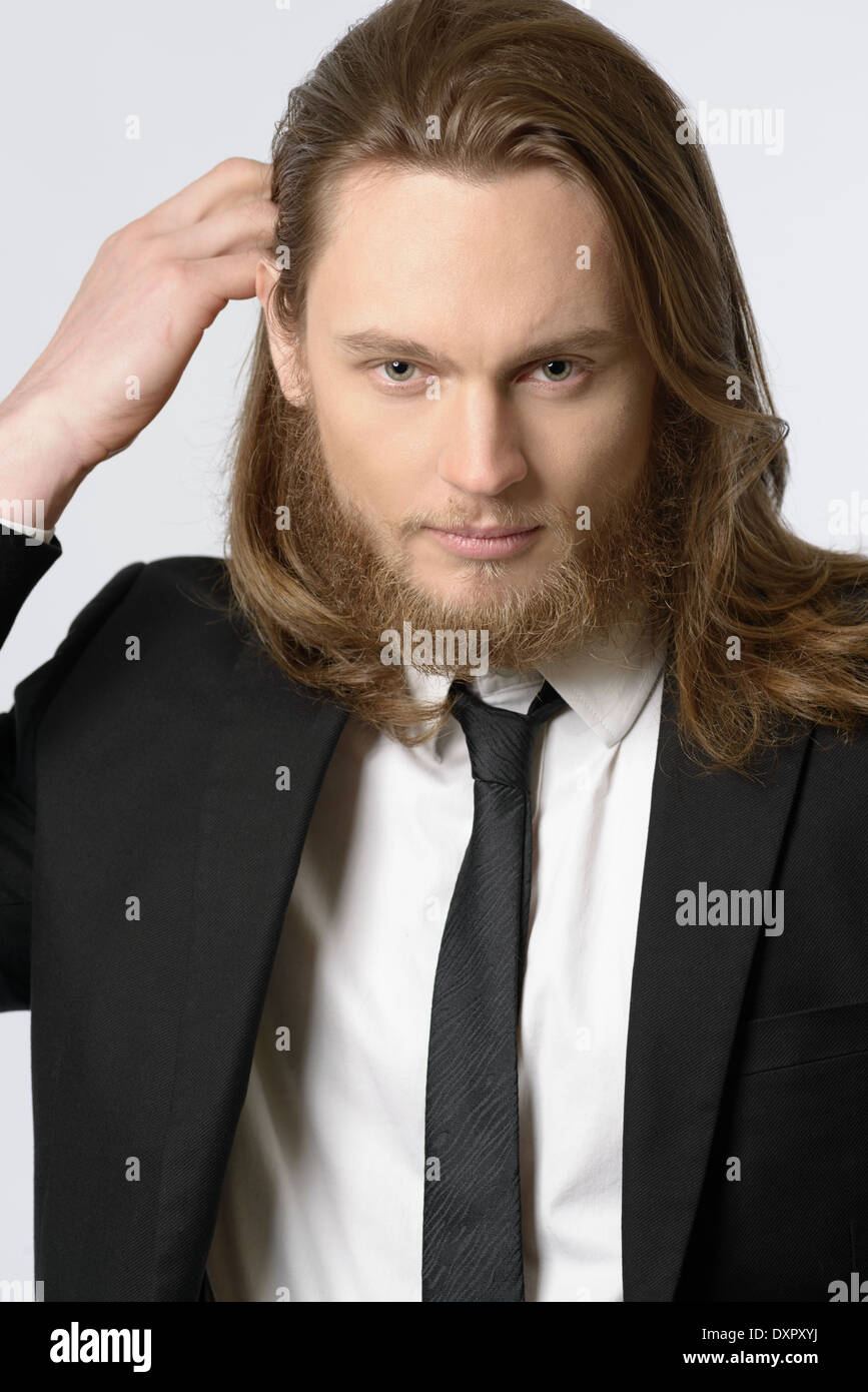 A Long Hair Man Male Model With Beard Wearing Necktie And