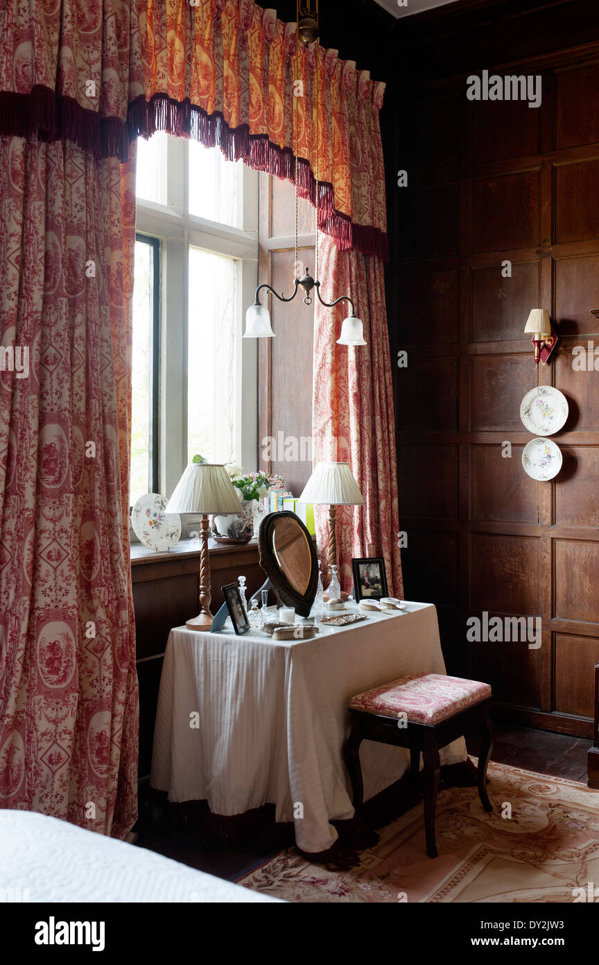 Toile De Jouy Curtains By Design Archive And Dressing Table In Bedroom With Wooden Wall Paneling And Decorative China Plates Stock Photo Alamy
