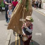 Small Boy With A Man Dressed In Horse Costume At The May Day Festival Stock Photo Alamy