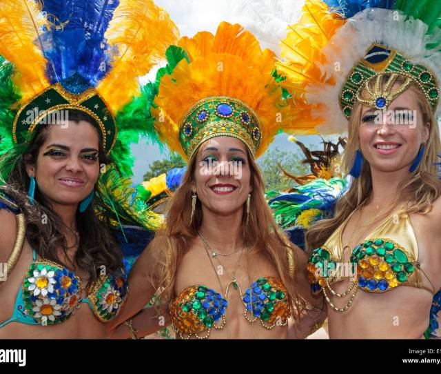 Three Women Dressed In Traditional Brazilian Mardi Gras Costumes Taking Part In Glasgows West End