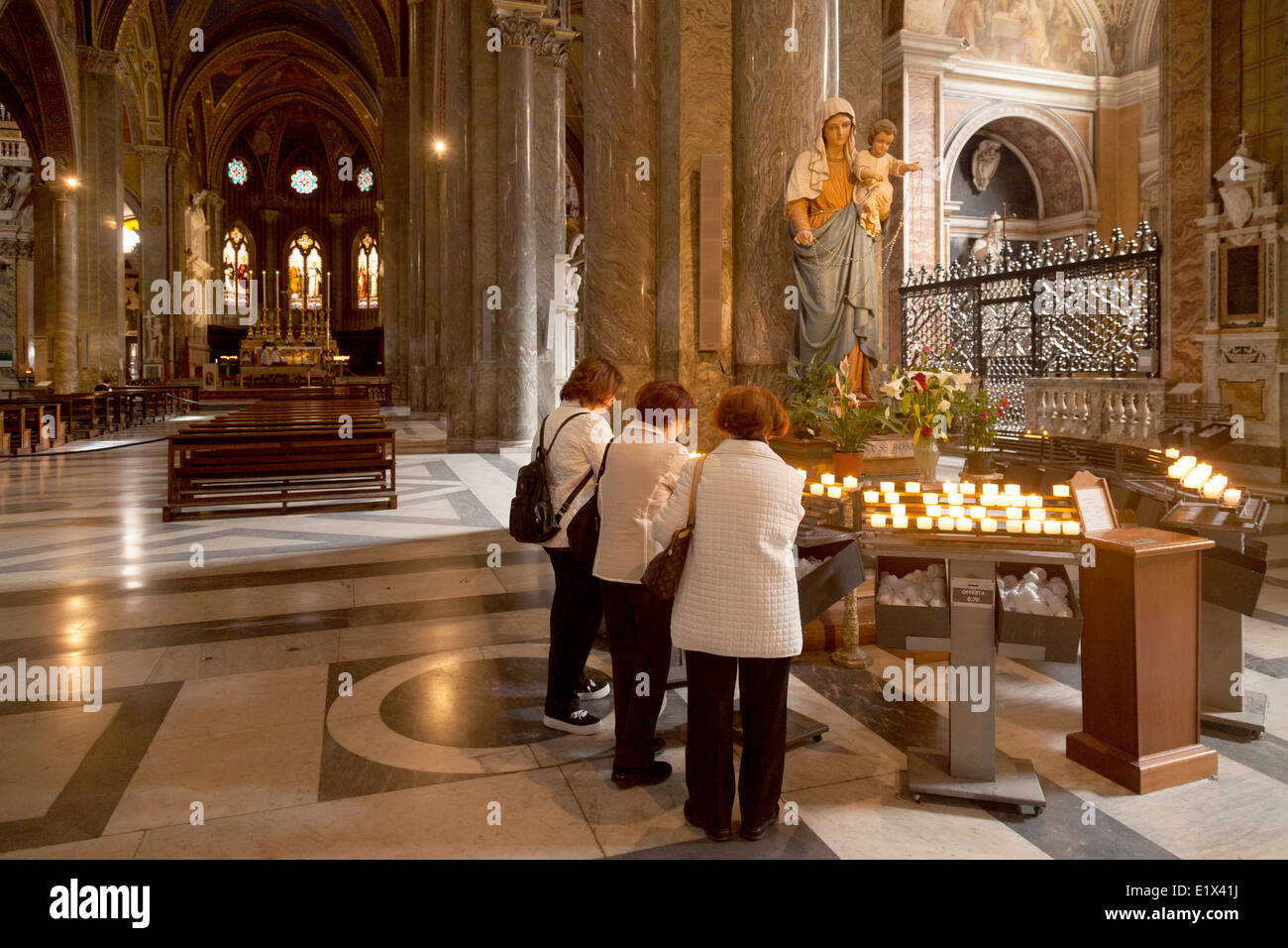 https www alamy com stock photo women lighting candles in the roman catholic church of santa maria 70030062 html