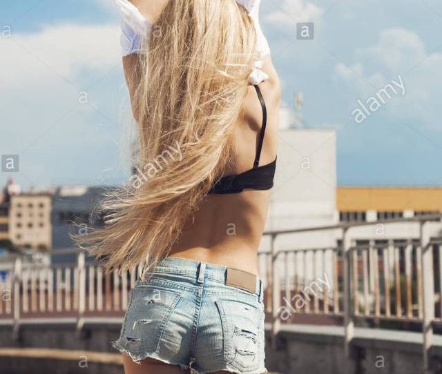 Blonde Young Woman Taking Off T Shirt Outdoor Portrait Of Teen Girl Stock