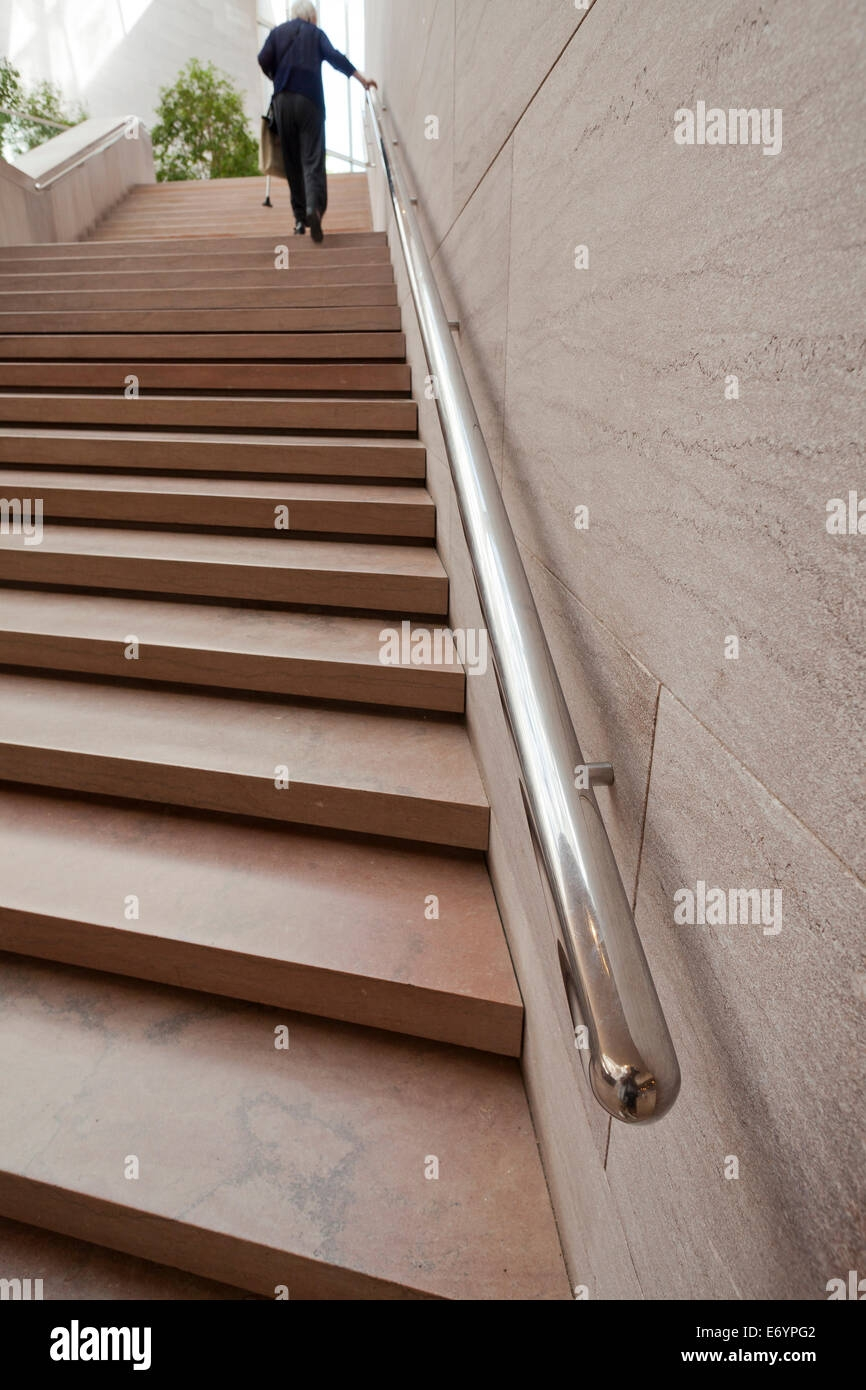 Elderly Woman Using Stair Hand Rail Usa Stock Photo Alamy   Stair Rails For Elderly   Stair Climbing   Down Stairs   Wood   Cmmc Handrail   Pipe