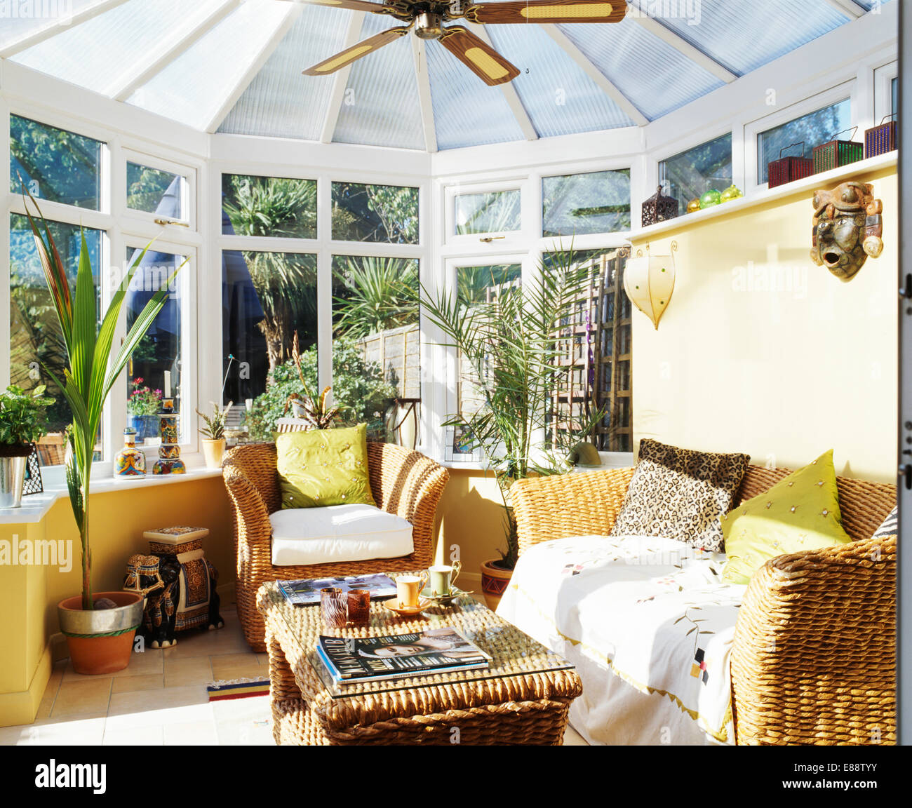 Lime Green Cushions On Wicker Sofa And Armchair In Conservatory Stock Photo Alamy