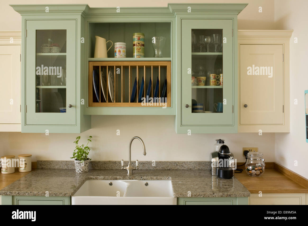 https www alamy com stock photo pale green wall cupboard above double sink in country kitchen 73972118 html