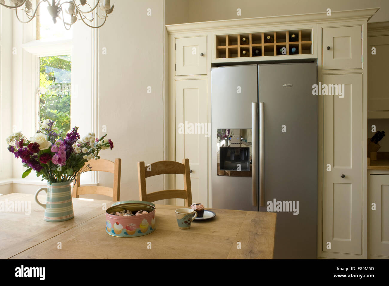 https www alamy com stock photo vase of summer flowers on table in country kitchen with wine storage 73972121 html